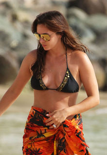 Jodi Albert in black bikini on the beach in Barbados