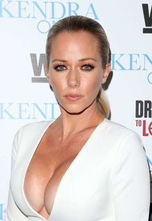 Kendra Wilkinson deep sexy cleavage in white jumpsuit