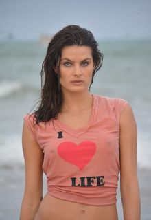 Isabeli Fontana in wet see through top on the set of a photoshoot at Maragogi Beach