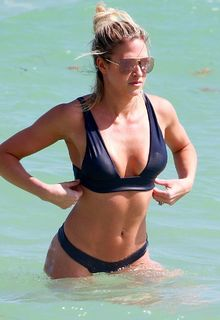 Kelly Kelly in dark blue bikini on the beach in Miami - February 27, 2017
