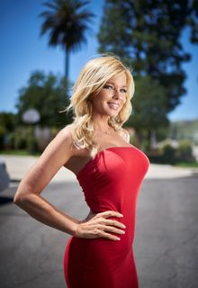 Donna D'Errico in tight red dress at home photoshoot - May 2019