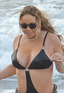 Mariah Carey nipple slip in black bikini in Hawaii