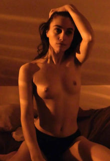 Claire Saumande shows her nude tits at Ton petit je (2021)